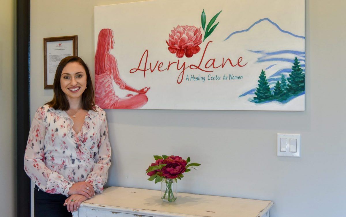 Camille in front of Avery Lane sign