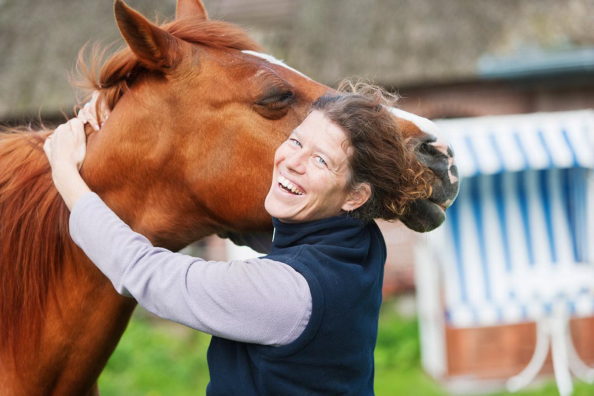 Hugging a horse